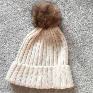 Beanie hat with poof ball